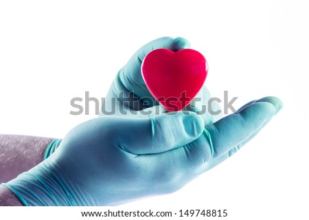 Medical doctor holding heart. Health insurance concept - stock photo