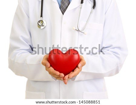 Medical doctor holding heart  isolated on white - stock photo