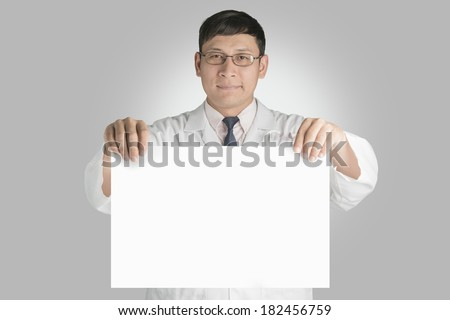 Medical doctor holding paper for writing.