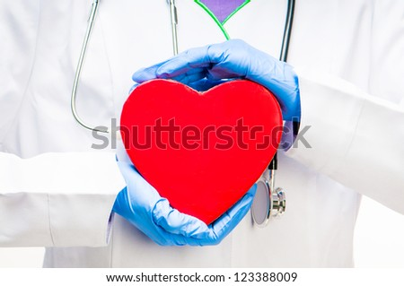 medical doctor holding red heart symbol close up - stock photo
