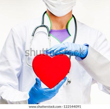 medical doctor holding red heart symbol on white background - stock photo