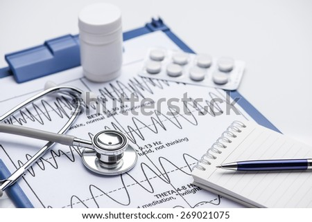 Medical doctor insurance and healthcare concept: clipboard with prescription medicine drug claim form, stethoscope, eyeglasses and blue ballpoint pen isolated on white background - stock photo