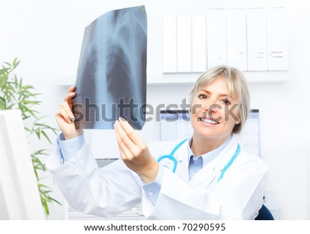 Medical doctor looking at a x-ray image in the office