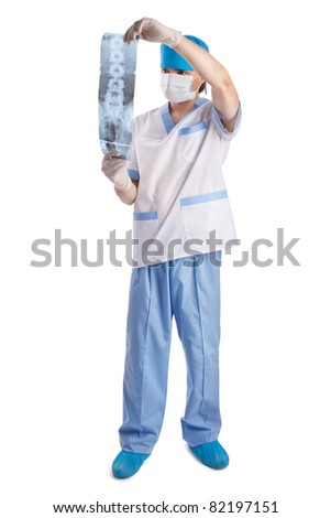 medical doctor looking at x-ray picture of spinal column  isolated on white background