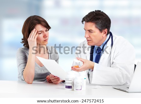 Medical Doctor man and patient woman in hospital - stock photo