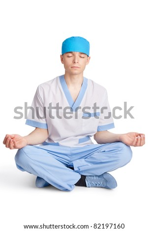 medical doctor meditating in lotus pose isolated on white background
