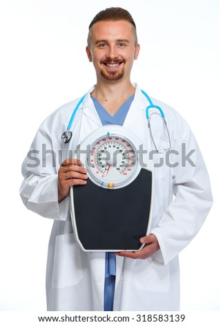 Medical doctor nutritionist with body scales. Weight loss. - stock photo