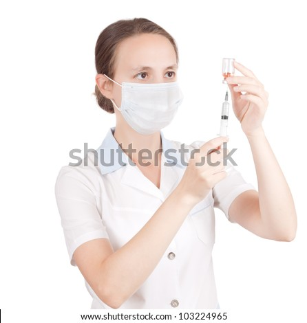 Medical doctor or nurse loading syringe for injection - stock photo