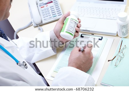 Medical doctor pharmacist working in the office - stock photo