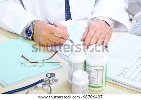 Medical doctor pharmacist working in the office