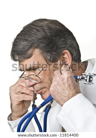Medical doctor removing or putting on his stethoscope. Shot against a white background - stock photo