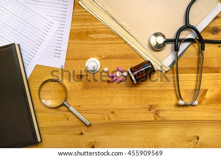 Medical doctor's general practitioner office desk top view as copy space, healthcare still life - stock photo