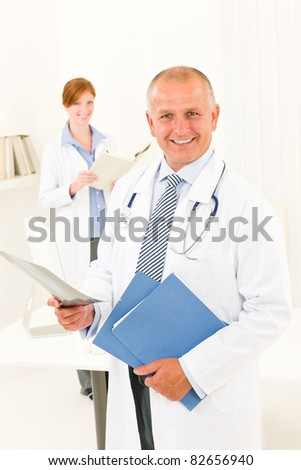 Medical doctor team senior man with female nurse hold x-ray