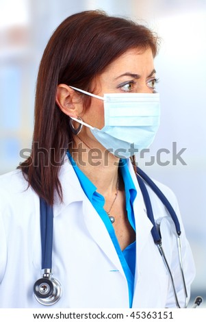 Medical doctor with mask and stethoscope.