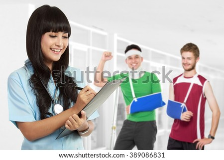 medical doctor with patient at the background using crutch - stock photo
