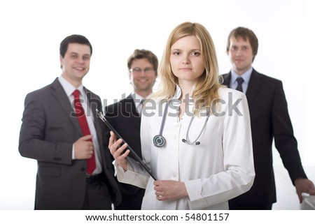 Medical doctor with stethoscope and the administration in the background - stock photo