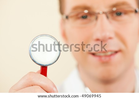 Medical doctor with stethoscope, focus is on the work tool