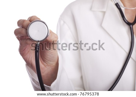 Medical doctor with stethoscope on white background - stock photo
