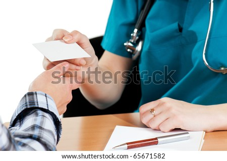 Medical doctor with visiting card and patient on white background - stock photo