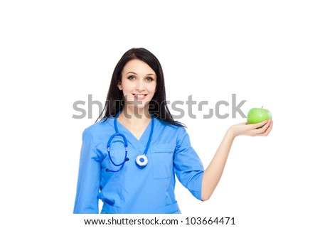 medical doctor woman dentist smile with stethoscope hold green fresh apple in hand, nurse wear blue surgery suit, Isolated over white background - stock photo