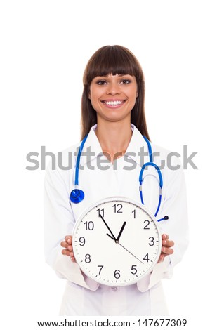 medical doctor woman smile hold clock, in hand. nurse  with stethoscope Isolated over white background - stock photo