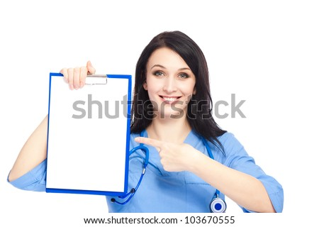 medical doctor woman smile with stethoscope clipboard point finger to clipboard, concept of advertisement product, empty copy space. nurse wear blue surgery suit isolated over white background - stock photo