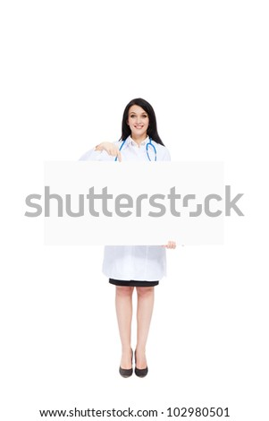 medical doctor woman smile with stethoscope hold blank card board point finger to empty copy space, concept of advertisement product, Full length portrait isolated over white background - stock photo