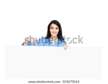 medical doctor woman smile with stethoscope hold blank card board point finger to empty copy space, concept of advertisement product, nurse wear blue surgery suit Isolated over white background - stock photo