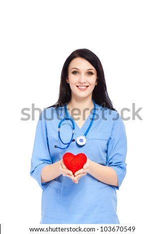 medical doctor woman smile with stethoscope hold red heart. nurse wear blue surgery suit. Isolated over white background - stock photo