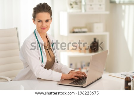 Medical doctor woman working on laptop - stock photo
