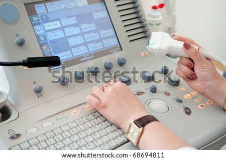 medical doctor working with ultrasound Equipment in medical center - stock photo