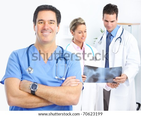 Medical doctors looking at a x-ray image in the office - stock photo