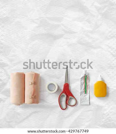 Medical elastic bandage rolls, bandage, first aid equipment, medicine background white paper. - stock photo