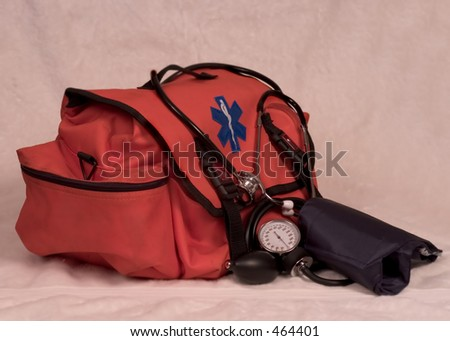 Medical (EMT) bag, blood pressure cuff (a.k.a. sphygmomanometer) and stethoscope. - stock photo