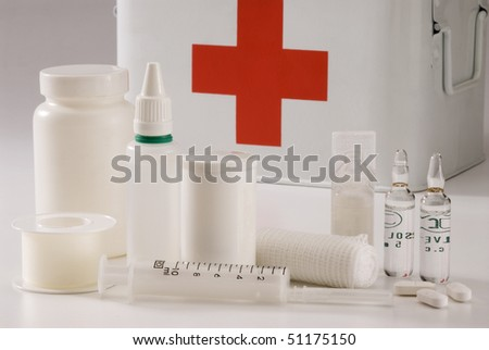 Medical equipment and a first aid box in the background. - stock photo