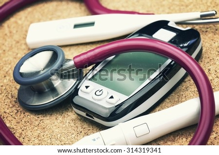 Medical equipment, Chek up equipment, Examining equipment, Thermometer, Stethoscope, Blood glucose meter. (Vintage Style Color) - stock photo