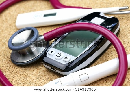 Medical equipment, Chek up equipment, Examining equipment, Thermometer, Stethoscope, Blood glucose meter. - stock photo