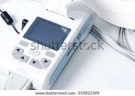 medical equipment for the measurement of ECG closeup cardiology heart health - stock photo