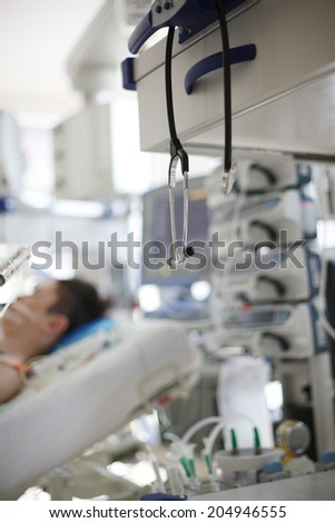 Medical equipment in hospital with background of patient sleeping in bed  - stock photo