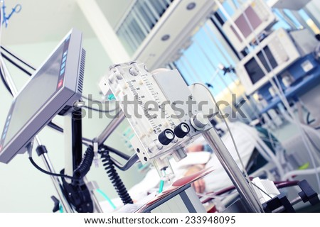 Medical equipment in the foreground of the patient's room  - stock photo