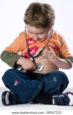 Medical examination by pediatrician with stethoscope - stock photo
