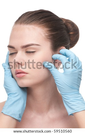 Medical examination face of beautiful woman - close-up portrait isolated on white