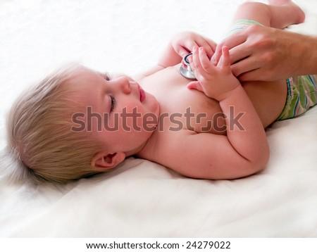 medical examination of baby with stethoscope - stock photo