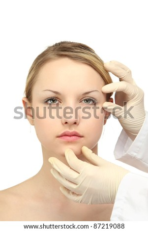Medical examination of beautiful woman face - close-up portrait isolated on white - stock photo
