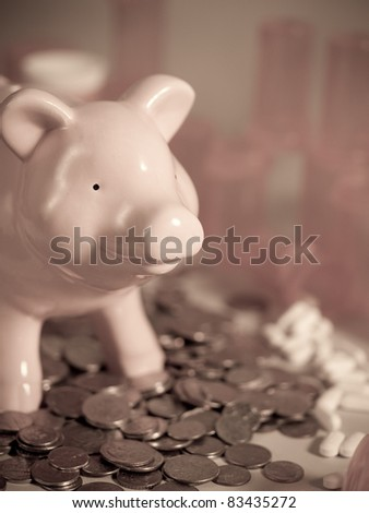 Medical expense concept.  Piggy bank with pills and coins, bottles in the back.