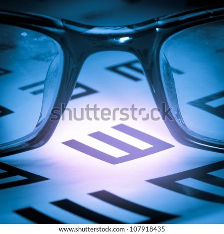 medical eye chart and glasses - stock photo