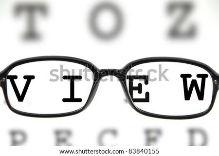 Medical eyeglasses on an eye chart - stock photo