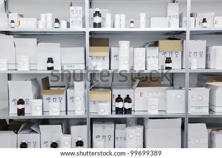 medical factory  supplies storage indoor with workers people - stock photo