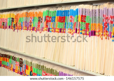 Medical files in a long row - stock photo