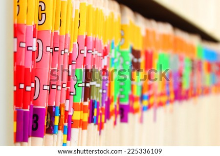 Medical files on a shelf - stock photo